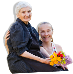 An elderly holding a bouquet of flowers accompanied by her granddaughter