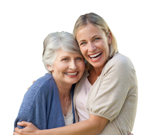 A happy elderly and caregiver hugging each other