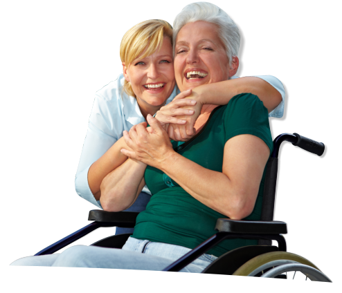 An elderly in a wheelchair accompanied by a caregiver